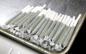 Marijuana joints are readied for sale in a medical marijuana center rolls in Denver